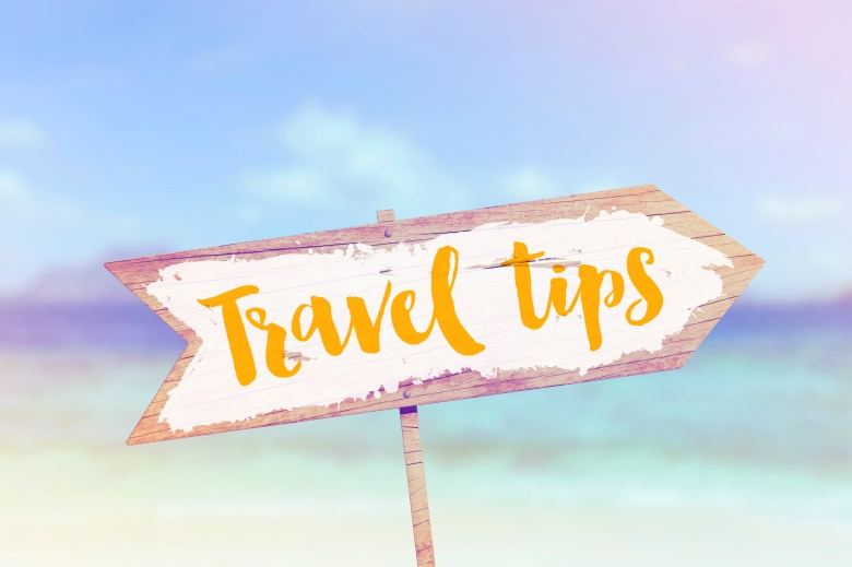 Travel tips summer wooden beach arrow sign