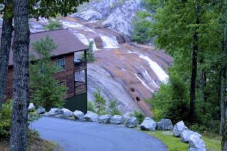home next to waterfall